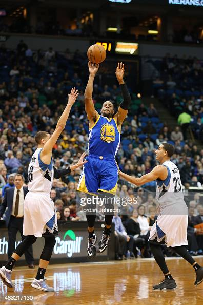 Andre Iguodala of the Golden State Warriors shoots against the Minnesota Timberwolvesduring the game on February 11 2015 at Target Center in...