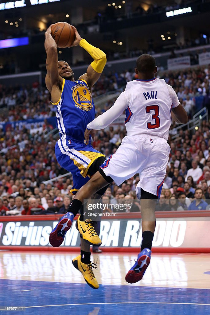 Andre Iguodala #9 of the Golden State Warriors shoots over Chris Paul #3 of the Los Angeles Clippers in Game Five of the Western Conference Quarterfinals during the 2014 NBA Playoffs at Staples Center on April 29, 2014 in Los Angeles, California.