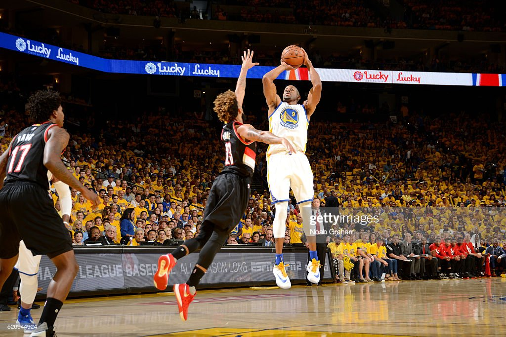 Andre Iguodala #9 of the Golden State Warriors shoots the ball during the game against Allen Crabbe #23 of the Portland Trail Blazers in Game One of the Western Conference Semifinals during the 2016 NBA Playoffs on May 1, 2016 at ORACLE Arena in Oakland, California.