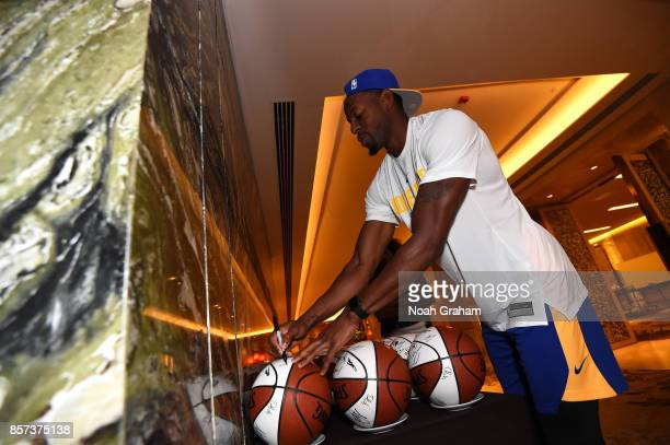 Andre Iguodala of the Golden State Warriors signs balls as part of the 2017 Global Games China at the Four Seasons hotel on October 4 2017 in...