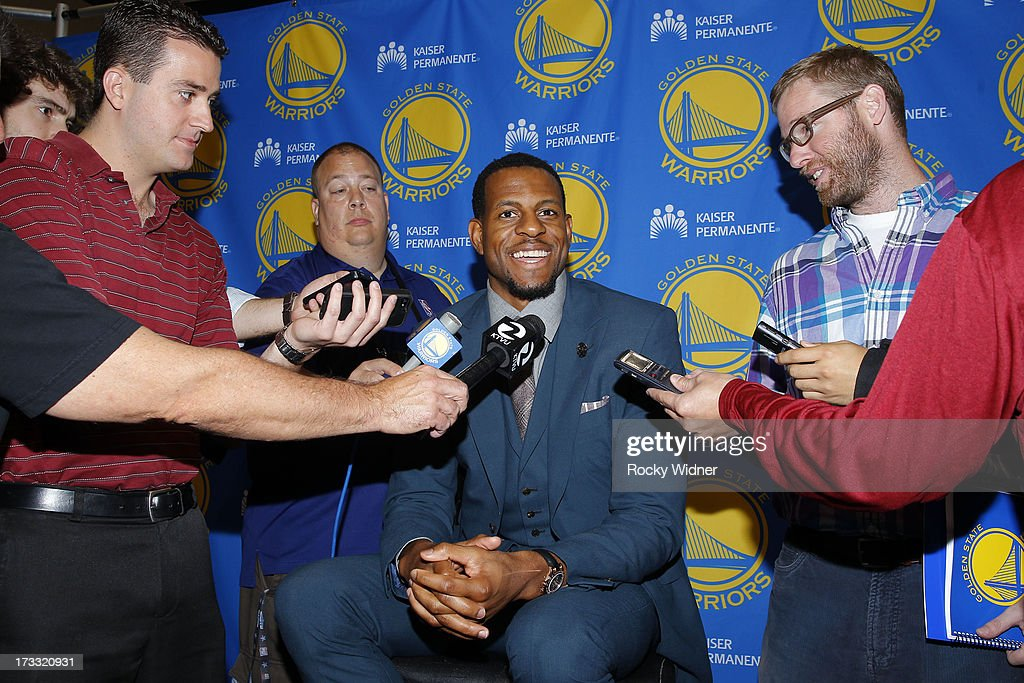 <a gi-track='captionPersonalityLinkClicked' href=/galleries/search?phrase=Andre+Iguodala&family=editorial&specificpeople=201980 ng-click='$event.stopPropagation()'>Andre Iguodala</a> #9 of the Golden State Warriors speaks at his introductory press conference on July 11, 2013 in Oakland, California.