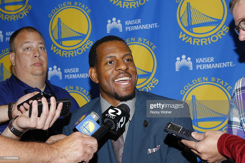 Andre Iguodala #9 of the Golden State Warriors speaks at his introductory press conference on July 11, 2013 in Oakland, California.