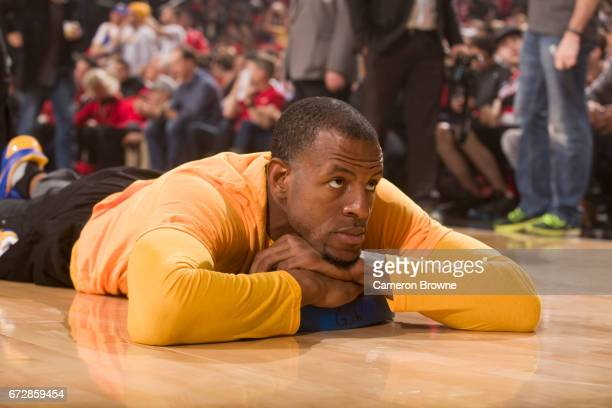 Andre Iguodala of the Golden State Warriors stretches before Game Three of the Western Conference Quarterfinals against the Portland Trail Blazers of...