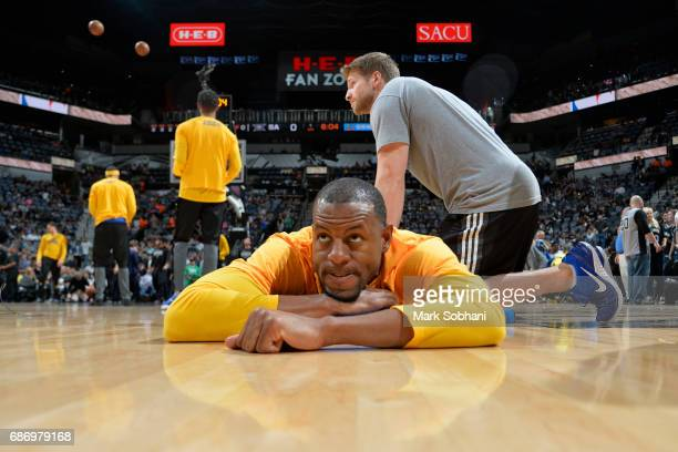 Andre Iguodala of the Golden State Warriors stretches before the game against the San Antonio Spurs during Game Four of the Western Conference Finals...