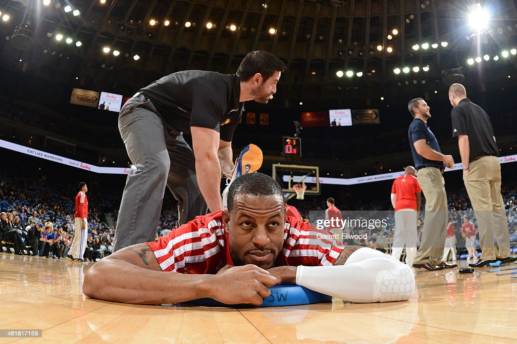 <a gi-track='captionPersonalityLinkClicked' href=/galleries/search?phrase=Andre+Iguodala&family=editorial&specificpeople=201980 ng-click='$event.stopPropagation()'>Andre Iguodala</a> #9 of the Golden State Warriors stretches out prior to the game against the Boston Celtics on January 10, 2014 at Oracle Arena in Oakland, California.