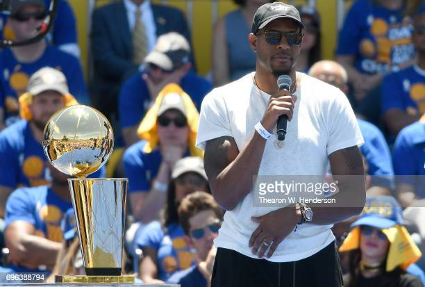 Andre Iguodala of the Golden State Warriors talks to the fans while they celebrate the Warriors 2017 NBA Championship at The Henry J Kaiser...