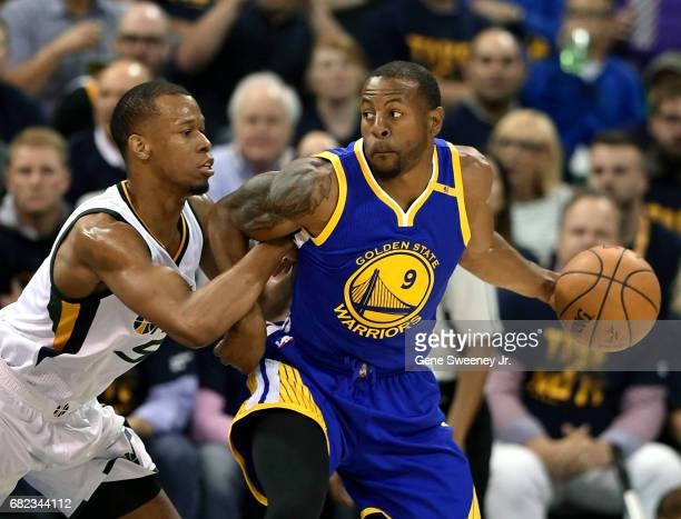 Andre Iguodala of the Golden State Warriors tangles with Dante Exum of the Utah Jazz in Game Four of the Western Conference Semifinals during the...