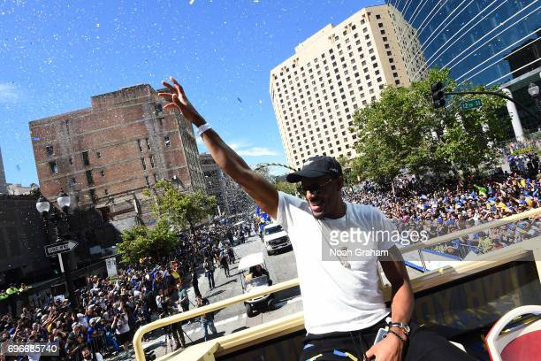 Andre Iguodala of the Golden State Warriors waves to the crowd during the Victory Parade and Rally on June 15 2017 in Oakland California at The Henry...