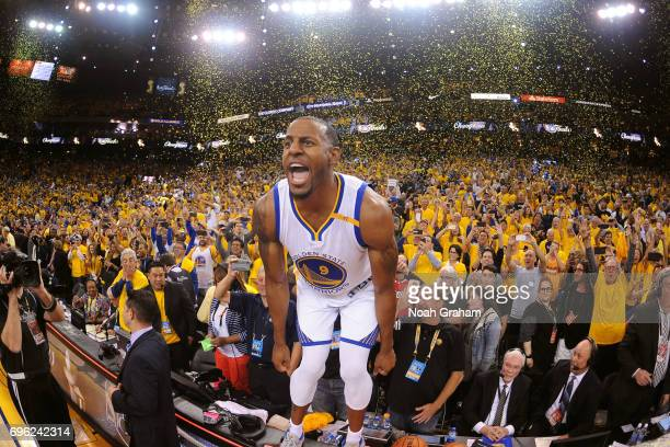 Andre Iguodala of the Golden State Warriors yells and celebrates on top of the scorers table after winning Game Five of the 2017 NBA Finals against...