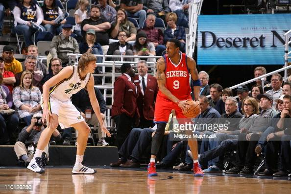 Andre Iguodala of the Philadelphia 76ers controls the ball against Andrei Kirilenko of the Utah Jazz during a game at EnergySolutions Arena on March...