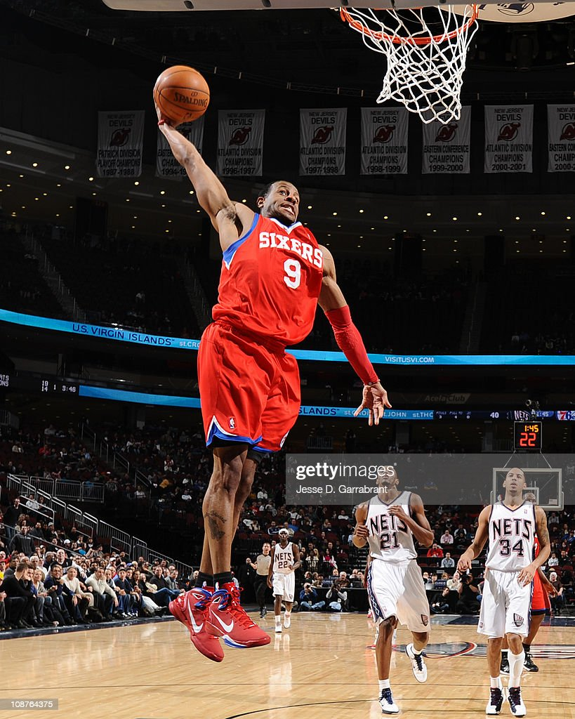 25e76725461 ... Andre Iguodala 9 of the Philadelphia 76ers dunks against the New Jersey  Nets during the ...