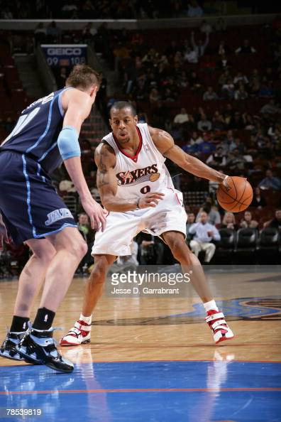 Andre Iguodala of the Philadelphia 76ers makes a move to the basket against Andrei Kirilenko of the Utah Jazz during the game at the Wachovia Center...