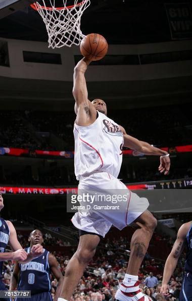 Andre Iguodala of the Philadelphia 76ers shoots against Andrei Kirilenko of the Utah Jazz on November 28 2007 at the Wachovia Center in Philadelphia...
