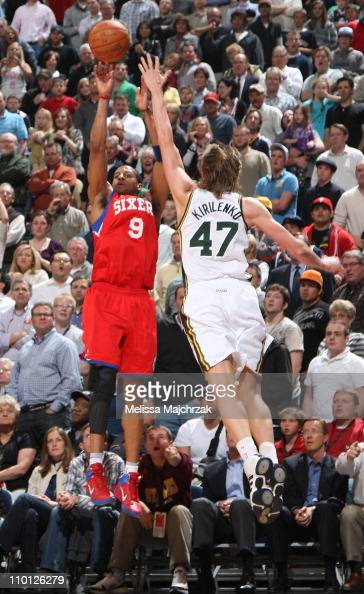 Andre Iguodala of the Philadelphia 76ers shoots the ball against Andrei Kirilenko of the Utah Jazz during a game at EnergySolutions Arena on March 14...