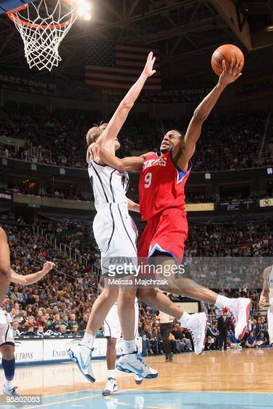 Andre Iguodala of the Philadelphia 76ers takes the ball to the basket against Andrei Kirilenko of the Utah Jazz during the game at EnergySolutions...
