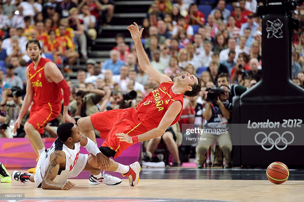 Andre Iguodala #9 of the United States fouls Rudy Fernandez #5 of Spain during the Men's Basketball gold medal game between the United States and Spain on Day 16 of the London 2012 Olympics Games at North Greenwich Arena on August 12, 2012 in London, England.