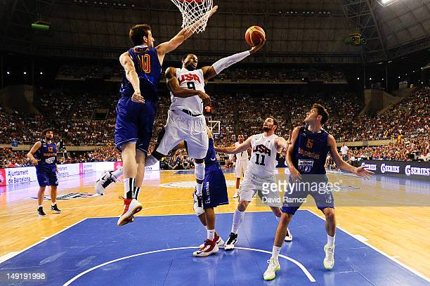 Andre Iguodala of the US Men's Senior National Team shoots against Victor Claver of the Spain Men's Senior National Team during a PreOlympic Men's...
