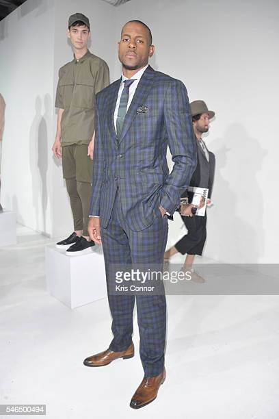 Andre Iguodala pose for photographers during the STAMPD Presentation at Skylight Clarkson Sq on July 12 2016 in New York City