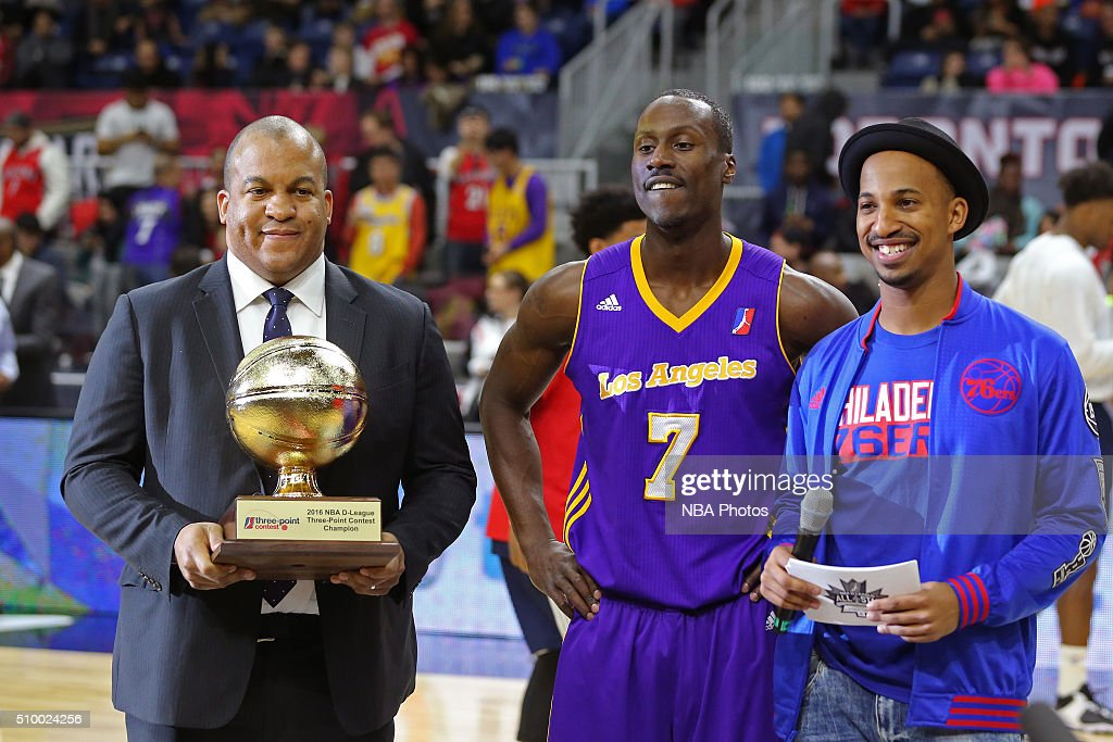 Andre Ingram #7 of the Los Angeles D-Fenders is presented the trophy by Malcolm Turner, President of the NBA Development League, after he wins the NBA D-League All-Star 3 Point Contest, presented by Kumho Tire, as part of 2016 All-Star Weekend at the Ricoh Coliseum on February 13, 2016 in Toronto, Ontario, Canada.