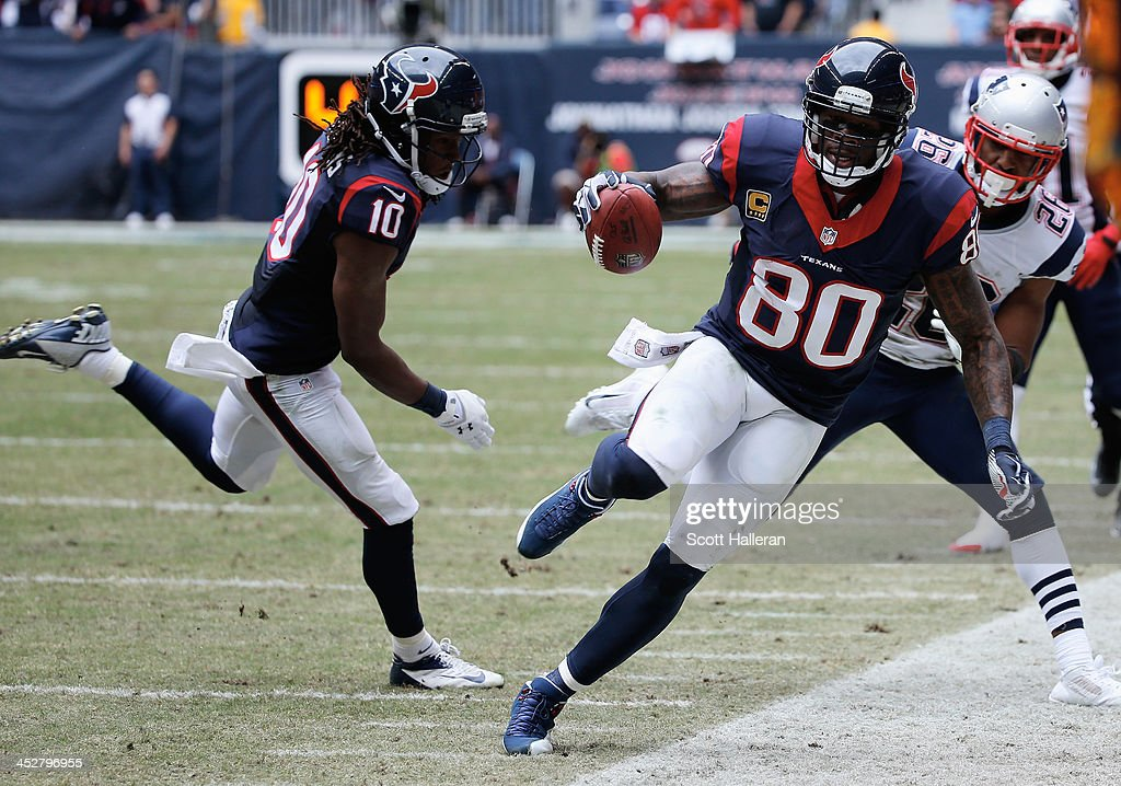 Andre Johnson #80 of Houston Texans catches a pass in front of <a gi-track='captionPersonalityLinkClicked' href=/galleries/search?phrase=Logan+Ryan&family=editorial&specificpeople=8222226 ng-click='$event.stopPropagation()'>Logan Ryan</a>#26 of the New England Patriots in the first half of the game at Reliant Stadium on December 1, 2013 in Houston, Texas.