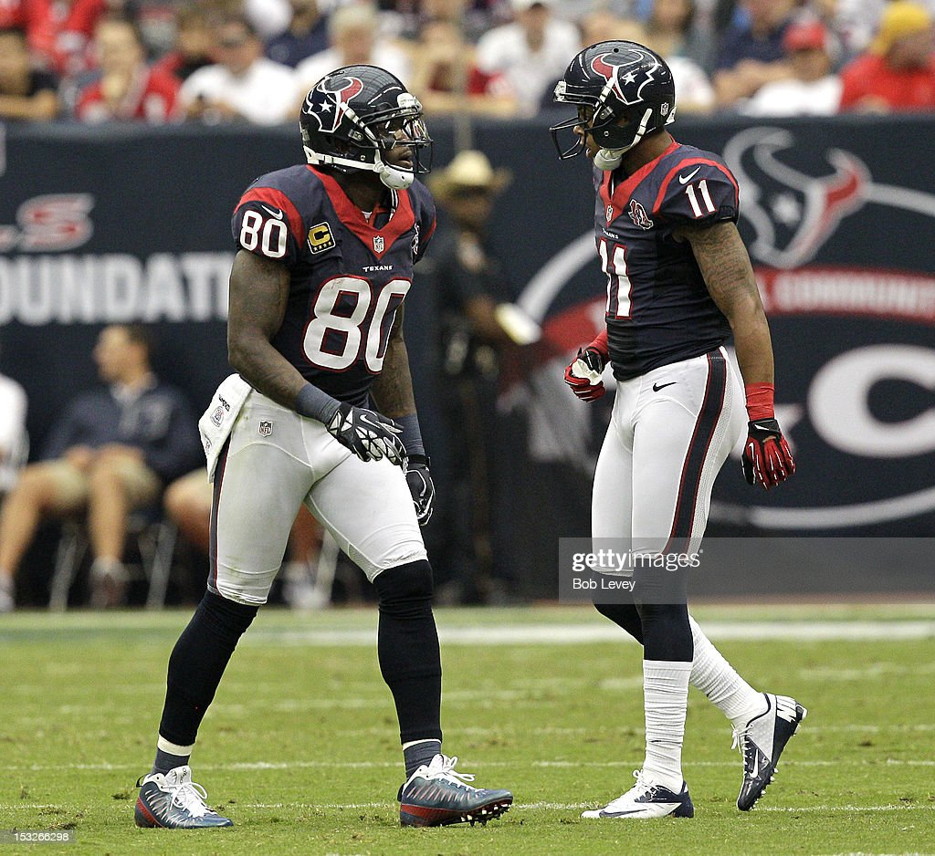 Andre Johnson #80 of the Houston Texans and <a gi-track='captionPersonalityLinkClicked' href=/galleries/search?phrase=DeVier+Posey&family=editorial&specificpeople=5571641 ng-click='$event.stopPropagation()'>DeVier Posey</a> #11 of the Houston Texans during action against the Tennessee Titans at Reliant Arena at Reliant Park on September 30, 2012 in Houston, Texas. Houston Texans won 38-14.