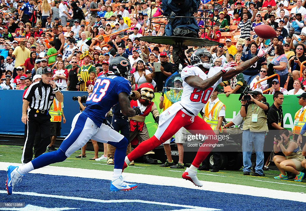 Andre Johnson #80 of the Houston Texans and the AFC goes up for a pass against <a gi-track='captionPersonalityLinkClicked' href=/galleries/search?phrase=Charles+Tillman&family=editorial&specificpeople=217609 ng-click='$event.stopPropagation()'>Charles Tillman</a> #33 of the National Football Conference team during the 2013 Pro Bowl at Aloha Stadium on January 27, 2013 in Honolulu, Hawaii