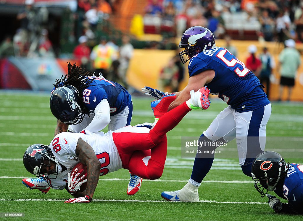 Andre Johnson #80 of the Houston Texans and the AFC is tackled by Charles Tillman #33 and Earl Thomas #29 of the National Football Conference team during the 2013 Pro Bowl at Aloha Stadium on January 27, 2013 in Honolulu, Hawaii