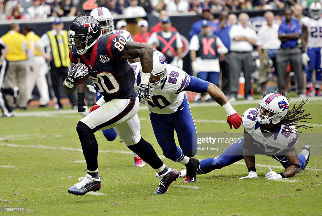 Andre Johnson #80 of the Houston Texans breaks the tackle of <a gi-track='captionPersonalityLinkClicked' href=/galleries/search?phrase=Leodis+McKelvin&family=editorial&specificpeople=4495839 ng-click='$event.stopPropagation()'>Leodis McKelvin</a> #21 of the Buffalo Bills and <a gi-track='captionPersonalityLinkClicked' href=/galleries/search?phrase=Nick+Barnett&family=editorial&specificpeople=167198 ng-click='$event.stopPropagation()'>Nick Barnett</a> #50 of the Buffalo Bills at Reliant Stadium on November 4, 2012 in Houston, Texas. Houston defeated Buffalo 21-9.