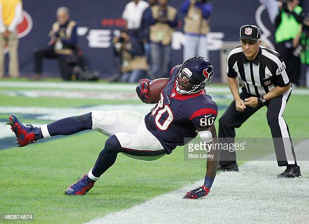 Andre Johnson of the Houston Texans catches a touchdown pass against the Jacksonville Jaguars in the fourth quarter in a NFL game on December 28 2014...