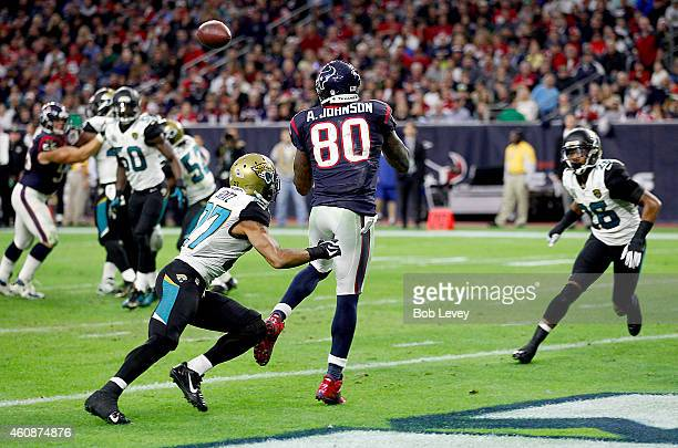 Andre Johnson of the Houston Texans catches a touchdown pass while Dwayne Gratz of the Jacksonville Jaguars covers in the fourth quarter in a NFL...