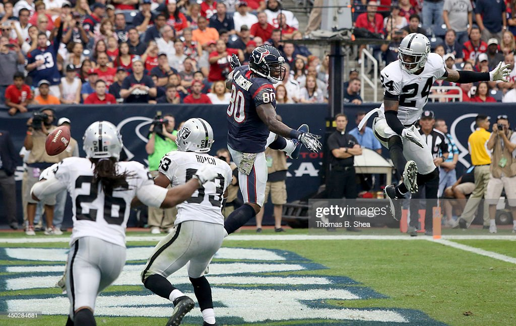 Andre Johnson #80 of the Houston Texans drops the pass while <a gi-track='captionPersonalityLinkClicked' href=/galleries/search?phrase=Charles+Woodson&family=editorial&specificpeople=218111 ng-click='$event.stopPropagation()'>Charles Woodson</a> #24 of the Oakland Raiders defends on November 17, 2013 at Reliant Stadium in Houston, Texas. Raiders won 28 to 23.