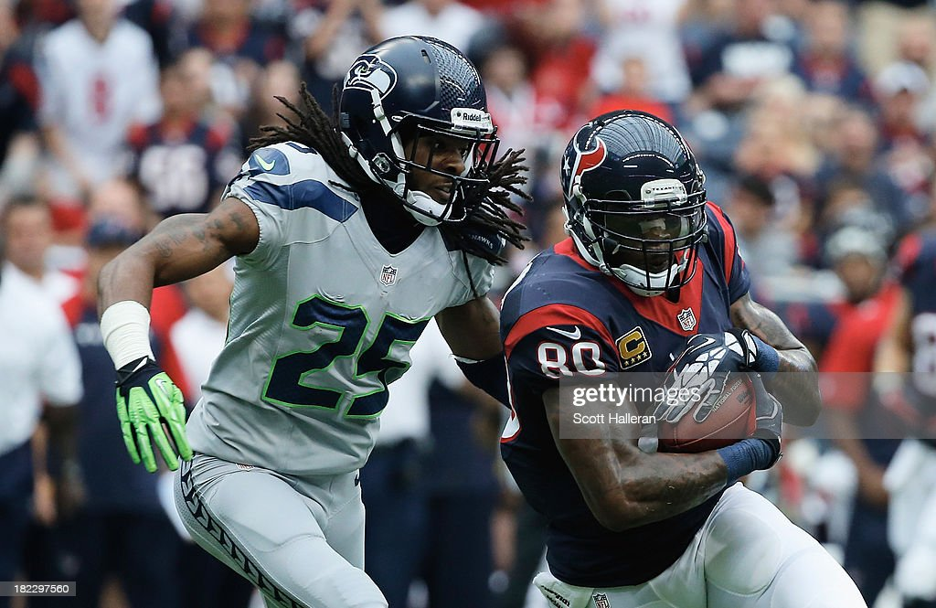 Andre Johnson #80 of the Houston Texans hauls in a pass in front of Richard Sherman #25 of the Seattle Seahawks at Reliant Stadium on September 29, 2013 in Houston, Texas.