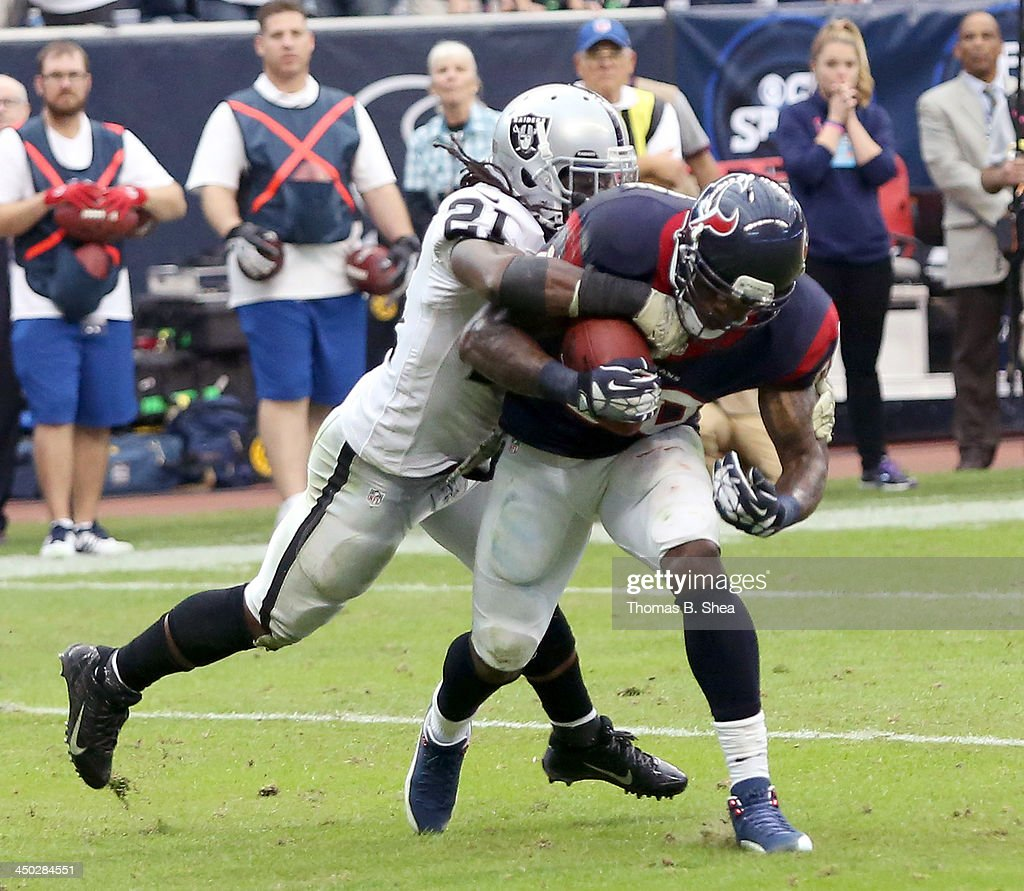 Andre Johnson #80 of the Houston Texans is tackled by Mike Jenkins #21 of the Oakland Raiders on November 17, 2013 at Reliant Stadium in Houston, Texas. Raiders won 28 to 23.