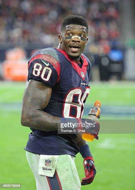 Andre Johnson of the Houston Texans on the sidelines drinking Gatorade while watching the Texans defense play against the Jacksonville Jaguars in a...