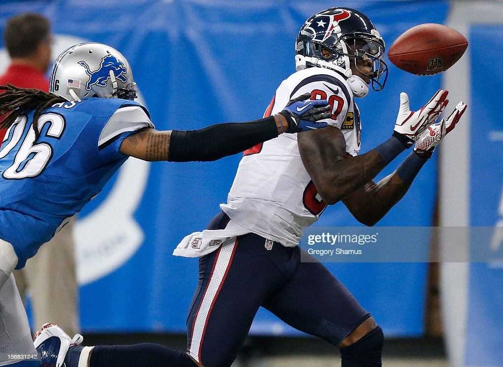 Andre Johnson #80 of the Houston Texans pulls in a second quarter catch in front of Louis Delmas #26 of the Detroit Lions at Ford Field on November 22, 2012 in Detroit, Michigan.