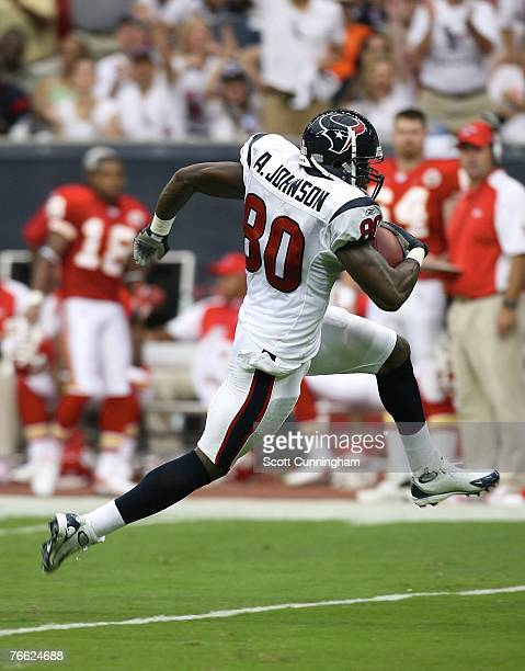 Andre Johnson of the Houston Texans runs for a touchdown against the Kansas City Chiefs at Reliant Stadium on September 9 2007 in Houston Texas