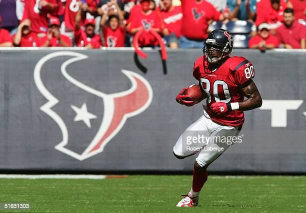 Andre Johnson of the Houston Texans runs with the ball in the first half of the game against the Jacksonville Jaguars on October 31 2004 at the...