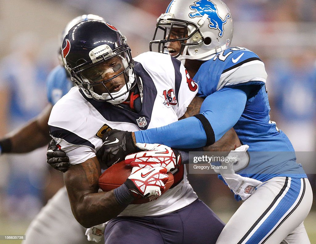Andre Johnson #80 of the Houston Texans tries to get around the tackle of Chris Houston #23 of the Detroit Lions after a overtime catch at Ford Field on November 22, 2012 in Detroit, Michigan. Houston won the game 34-31.