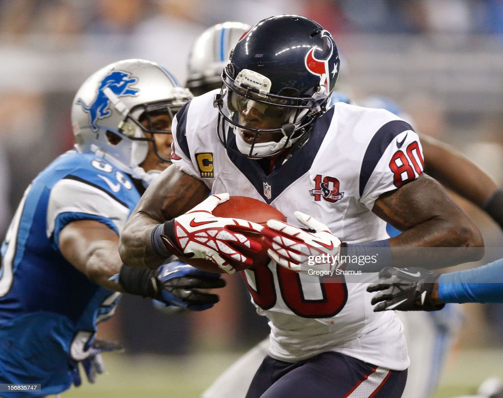 Andre Johnson #80 of the Houston Texans tries to get around the tackle of Ricardo Silva #39 of the Detroit Lions after a overtime catch at Ford Field on November 22, 2012 in Detroit, Michigan. Houston won the game 34-31.