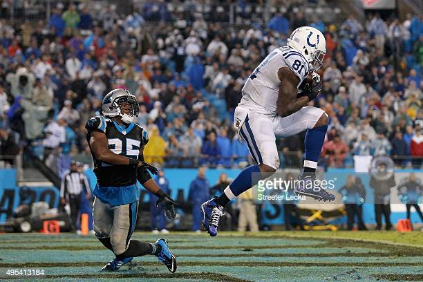 Andre Johnson of the Indianapolis Colts catches a 4th quarter touchdown pass against Bene' Benwikere of the Carolina Panthers during their game at...