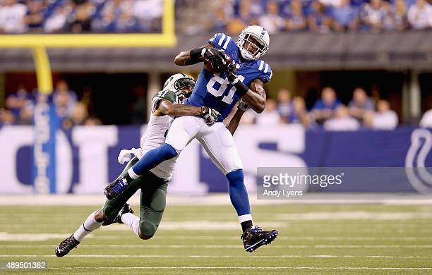 Andre Johnson of the Indianapolis Colts catches a pass while defended by Buster Skrine of the New York Jets during the game at Lucas Oil Stadium on...