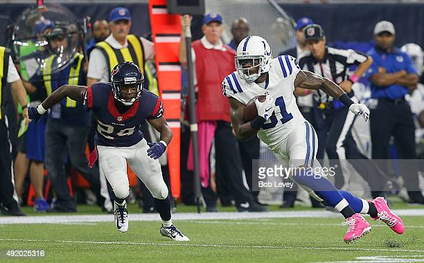 Andre Johnson of the Indianapolis Colts runs past Johnathan Joseph of the Houston Texans after completeing a catch at NRG Stadium on October 8 2015...