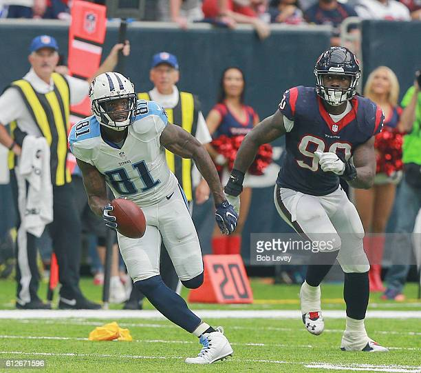 Andre Johnson of the Tennessee Titans runs with the ball as Jadeveon Clowney of the Houston Texans pursues at NRG Stadium on October 2 2016 in...