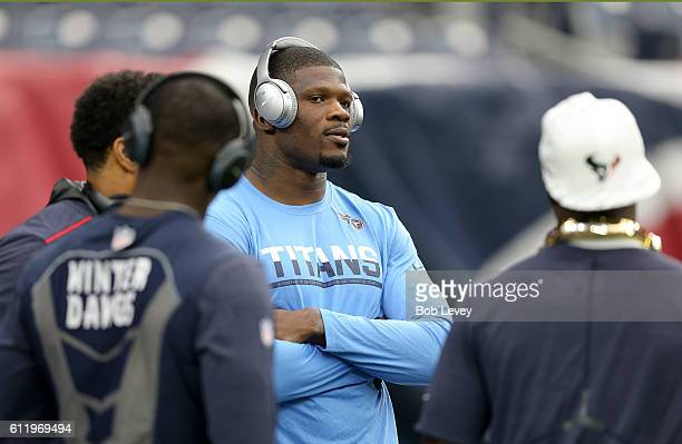 Andre Johnson of the Tennessee Titans visits with former teammates before the game against the Houston Texans at NRG Stadium on October 2 2016 in...