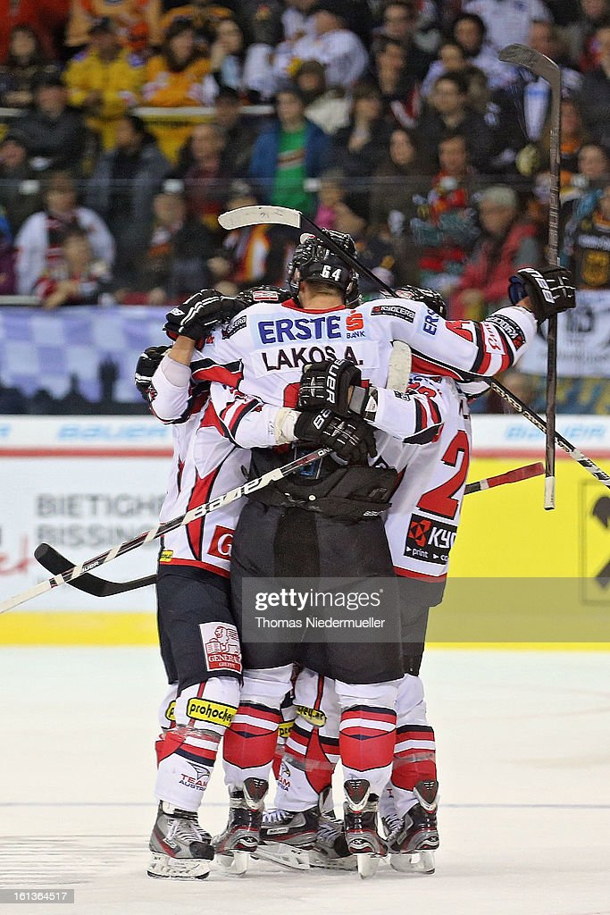 Andre Lakos (C) of Austria celebrates his goal during the Olympic Icehockey Qualifier match between Germany and Austria on February 10, 2013 in Bietigheim-Bissingen, Germany.