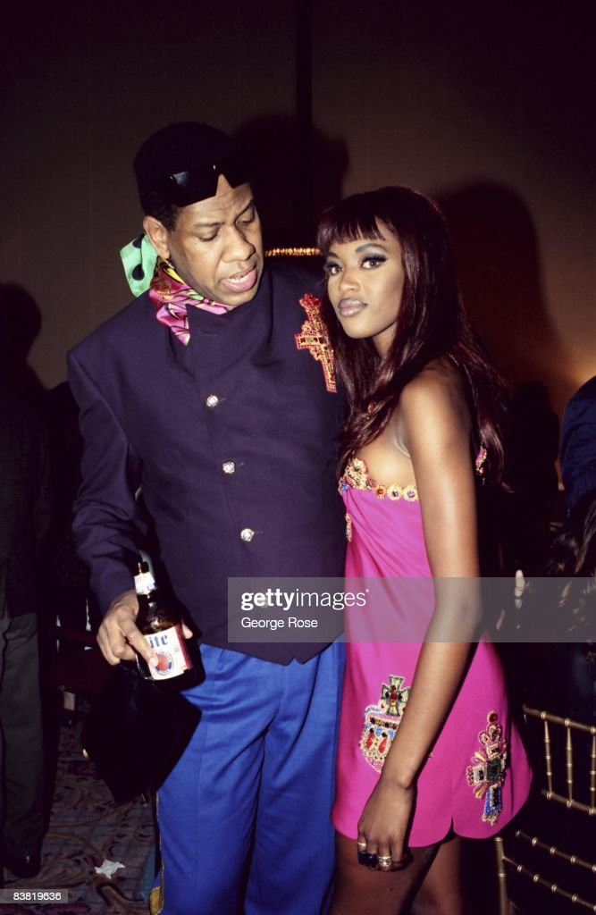 Andre Leon Talley and Naomi Campbell, who is wearing the latest from Italian designer and toast of Paris, Miami and New York, Gianni Versace, greet each other at a 1991 Los Angeles, California, fashion show.
