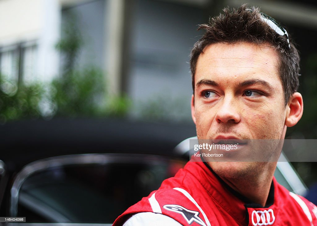 <a gi-track='captionPersonalityLinkClicked' href=/galleries/search?phrase=Andre+Lotterer&family=editorial&specificpeople=2380096 ng-click='$event.stopPropagation()'>Andre Lotterer</a> of Germany and Audi Sport Team E-Tron Ultra attends the drivers parade during previews for the Le Mans 24 Hour race on June 15, 2012 in Le Mans, France.
