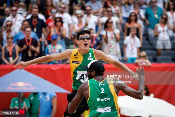 Andre Loyola and Evandro of Brazil celebrate after the Men's Quarterfinal match between Canada and Brazil on August 05 2017 in Vienna Austria