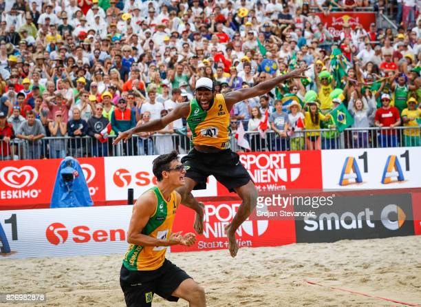 Andre Loyola and Evandro of Brazil celebrate victory after the Men's Gold medal match between Brazil and Austria on August 06 2017 in Vienna Austria
