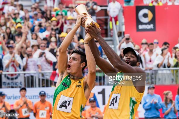 Andre Loyola Stein and Evandro Goncalves Oliveira Junior of Brazil celebrate first place at FIVB Beach Volleyball World Championships on August 6...